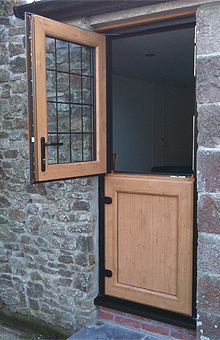 Just Doors and Windows supply and install Dark green stable doors in Worcester, Worcestershire