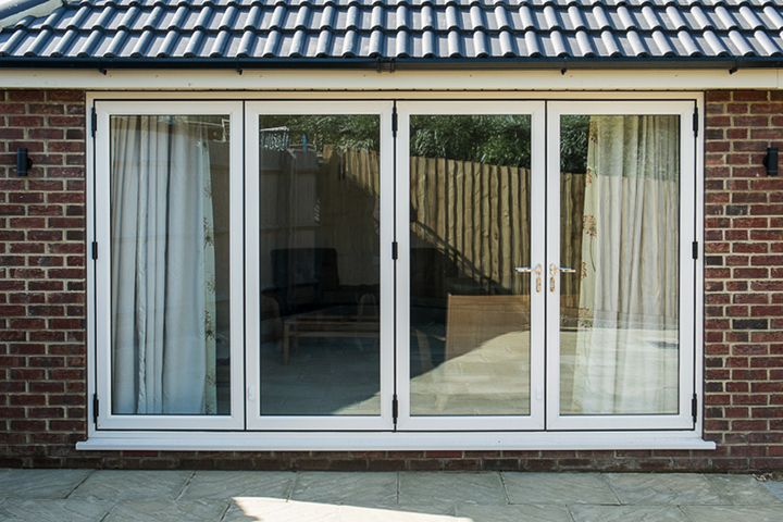 white multifold doors reading Headstart Home Improvements