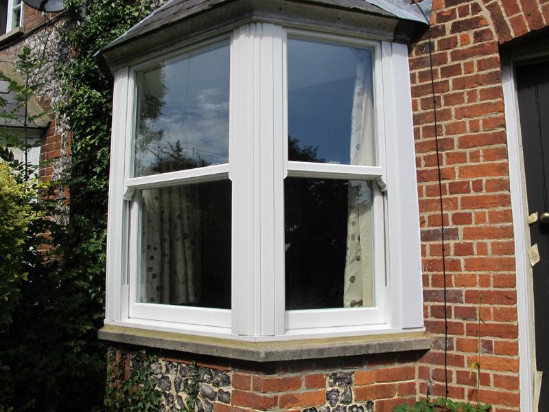 Upvc vertical sliding windows buckinghamshire burgess for Vertical sliding window design
