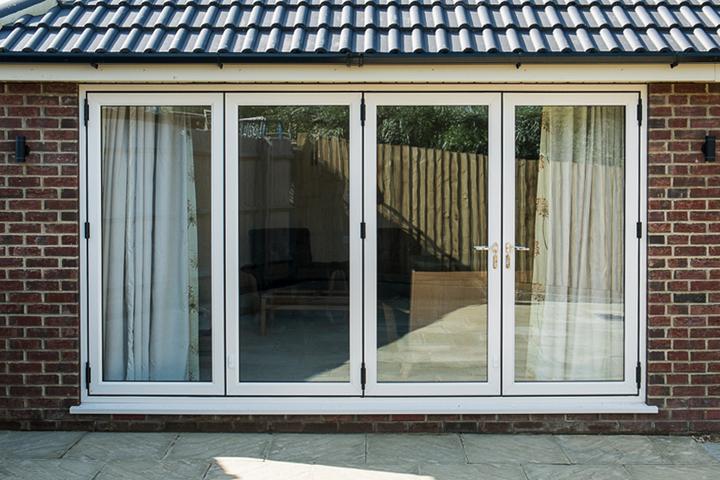 white multifold doors hampshire Pinnacle windows ltd